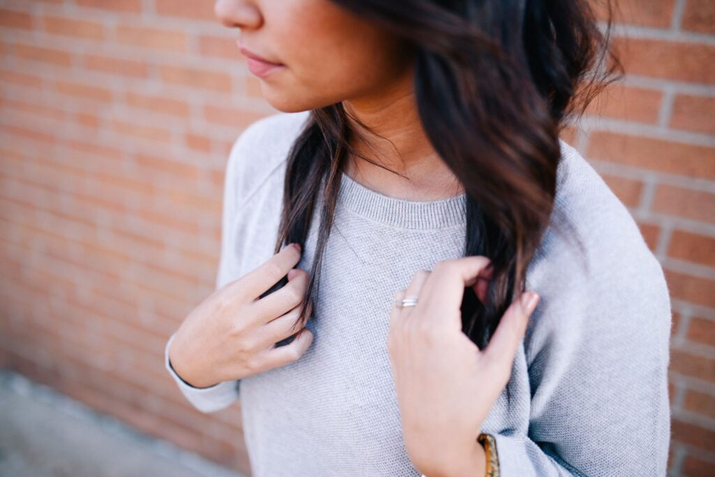 A Woman With Sweater